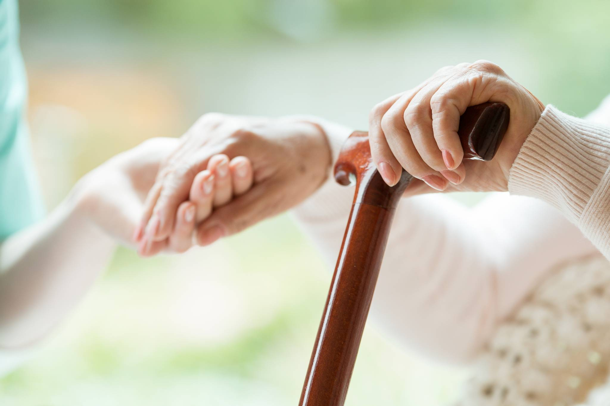 TriCare Aged Care Holding hands